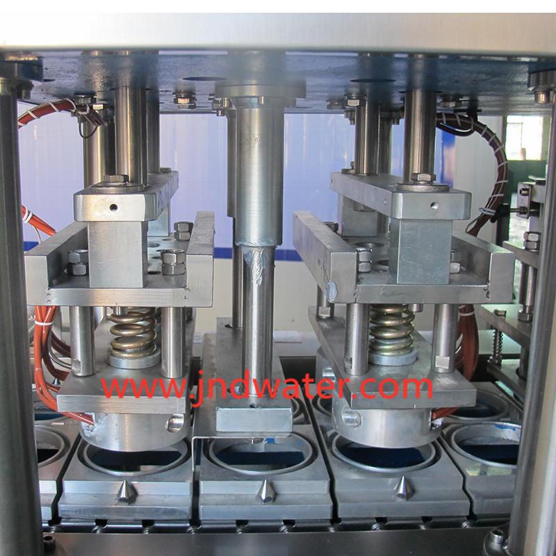 Автоматическая машина для наполнения и запечатывания стаканчиков