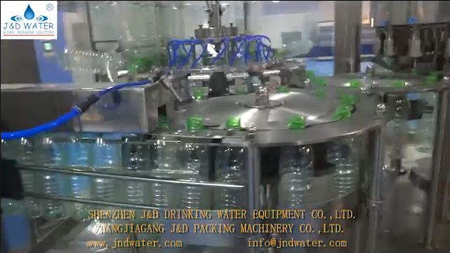 JNDWATER Bottled water filling machine and sleeve labeling work video